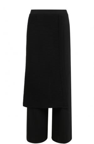 Шерстяные расклешенные брюки Yohji Yamamoto. Цвет: черный