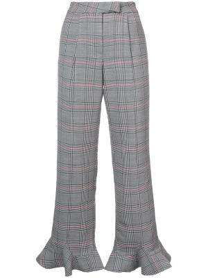 Клетчатые брюки с расклешенной оторочкой Rosie Assoulin. Цвет: чёрный
