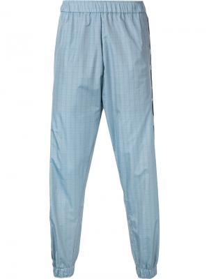 Клетчатые спортивные брюки с логотипом Astrid Andersen. Цвет: серый