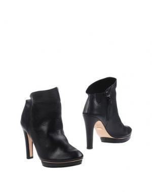 Полусапоги и высокие ботинки REPETTO. Цвет: черный