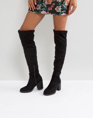 Truffle Collection Сапоги-ботфорты на массивном каблуке. Цвет: черный