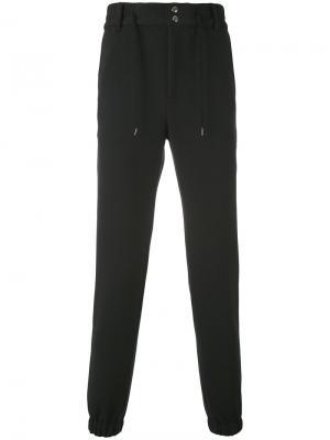 Спортивные брюки с карманами на молнии Bruno Bordese. Цвет: чёрный