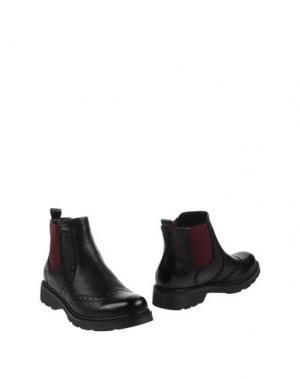 Полусапоги и высокие ботинки GIOIOSITA. Цвет: черный