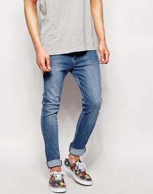 Dr Denim Суженные книзу джинсы слим с заниженным шаговым швом Leon. Цвет: синий