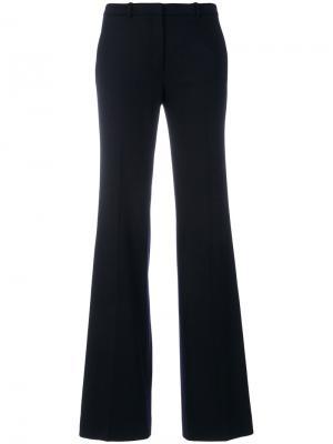 Расклешенные брюки Theory. Цвет: синий