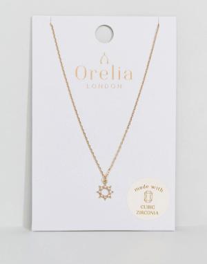 Orelia Ожерелье с кристаллами и подвеской в форме солнца. Цвет: золотой