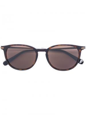 Солнцезащитные очки с круглой оправой Brioni. Цвет: коричневый