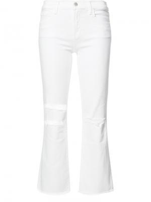 Укороченные джинсы с рваными деталями J Brand. Цвет: белый