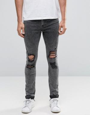 ASOS Рваные супероблегающие джинсы с эффектом кислотной стирки. Цвет: серый