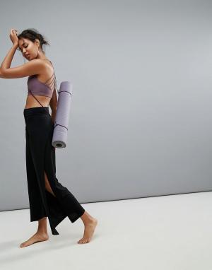 ONZIE Черные брюки для занятий йогой Pure Vida. Цвет: черный
