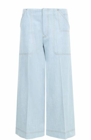 Укороченные расклешенные джинсы со стрелками Acne Studios. Цвет: голубой