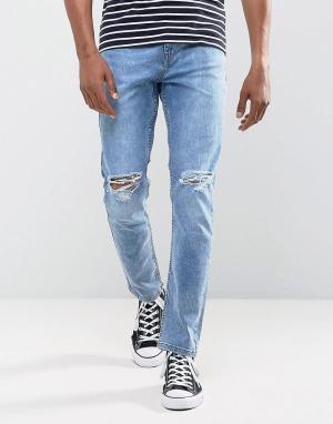 Antioch Голубые выбеленные эластичные джинсы зауженного кроя с рваной отделкой. Цвет: синий
