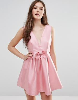 Pixie & Diamond Платье с бантом спереди. Цвет: розовый