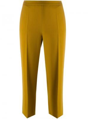 Укороченные расклешенные брюки Odeeh. Цвет: жёлтый и оранжевый