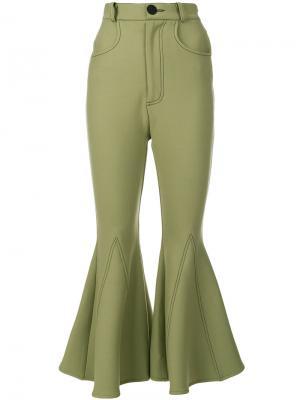 Расклешенные укороченные брюки Beaufille. Цвет: зелёный