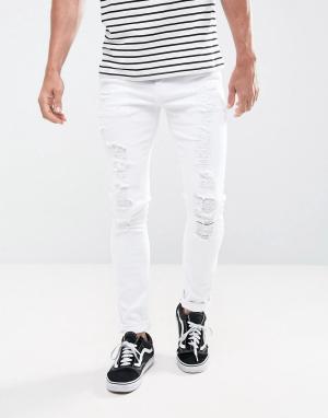 ASOS Супероблегающие белые джинсы с рваными коленями. Цвет: белый