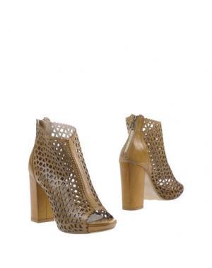 Полусапоги и высокие ботинки OVYE' by CRISTINA LUCCHI. Цвет: коричневый
