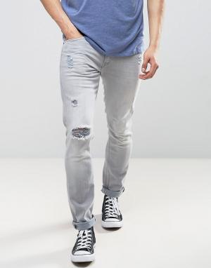 Lee Серые рваные джинсы скинни Luke. Цвет: серый