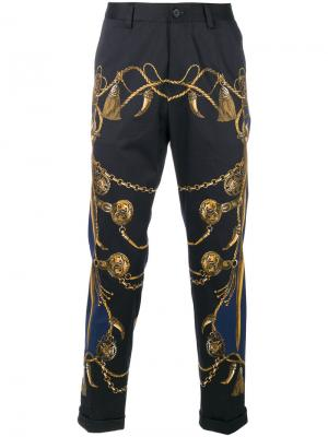 Укороченные брюки с принтом в стиле милитари Dolce & Gabbana. Цвет: синий
