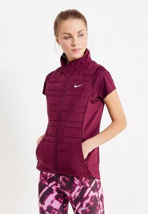 Жилет утепленный Nike. Цвет: фиолетовый