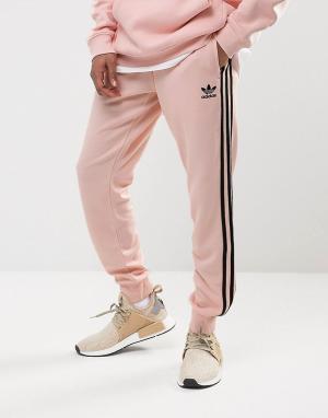 Adidas Originals Розовые джоггеры с манжетами Superstar BS4656. Цвет: розовый