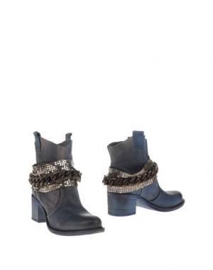 Полусапоги и высокие ботинки FABBRICA MORICHETTI. Цвет: синий