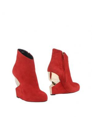 Полусапоги и высокие ботинки CHARLINE DE LUCA. Цвет: красный