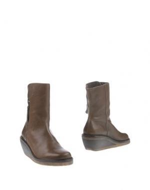 Полусапоги и высокие ботинки TRIPPEN. Цвет: хаки