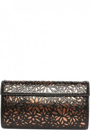 Клатч из кожи питона с перфорацией Alaia. Цвет: черный