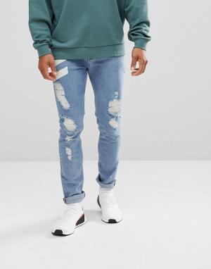 ASOS Выбеленные рваные джинсы скинни с шевронным принтом. Цвет: синий