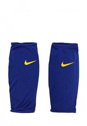 Щитки Nike. Цвет: синий