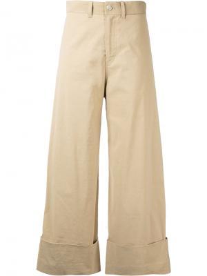 Укороченные расклешенные брюки Sea. Цвет: телесный