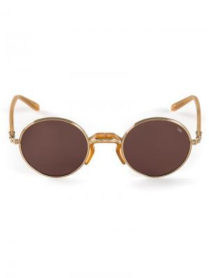 Солнцезащитные очки в круглой оправе Eyevan7285. Цвет: металлический