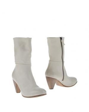 Полусапоги и высокие ботинки EL. Цвет: белый