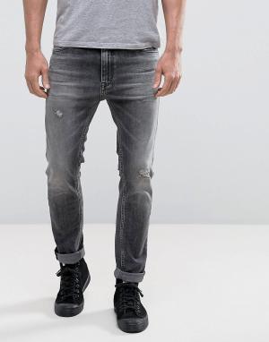 Calvin Klein Jeans Зауженные рваные джинсы с заплатками и эффектом кислотной стирки Calvi. Цвет: черный
