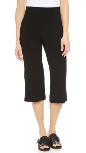 Расклешенные укороченные брюки из крепа Enza Costa. Цвет: голубой