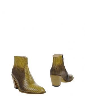 Полусапоги и высокие ботинки FREE LANCE. Цвет: желтый