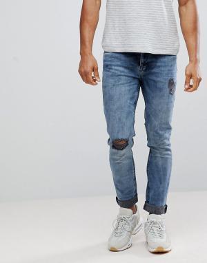 ASOS Сине-черные выбеленные джинсы скинни с рваными коленями. Цвет: черный