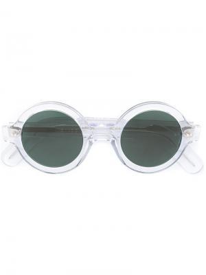 Солнцезащитные очки в круглой оправе Cutler & Gross. Цвет: телесный