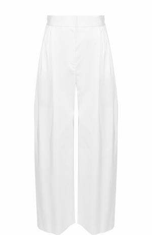 Укороченные широкие брюки с защипами The Row. Цвет: белый