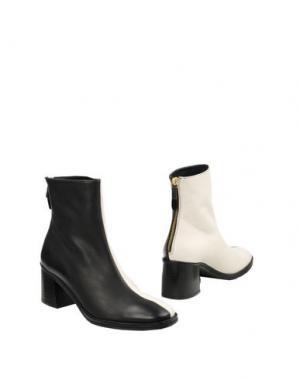 Полусапоги и высокие ботинки MIISTA. Цвет: черный