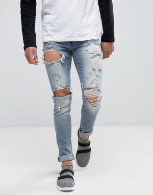ASOS Выбеленные голубые рваные джинсы скинни. Цвет: синий