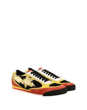 Низкие кеды и кроссовки JUST CAVALLI. Цвет: желтый