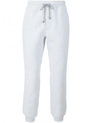 Зауженные спортивные брюки Brunello Cucinelli. Цвет: серый