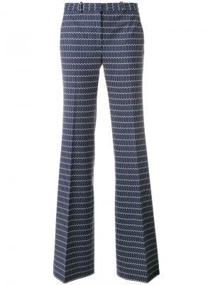 Расклешенные брюки с принтом Theory. Цвет: синий