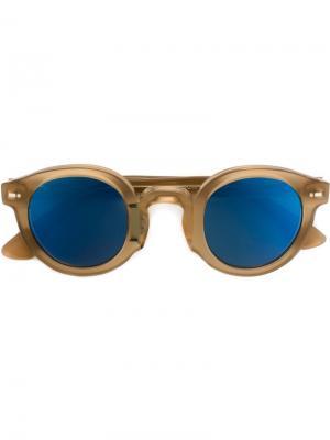 Солнцезащитные очки в круглой оправе Movitra. Цвет: телесный
