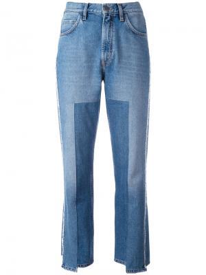 Укороченные асимметричные джинсы Mih Jeans. Цвет: синий