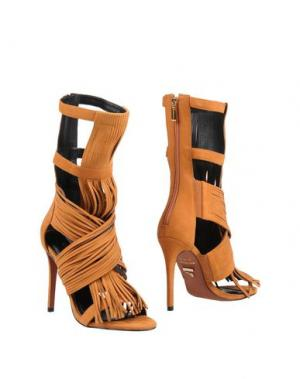 Полусапоги и высокие ботинки CARRANO. Цвет: желто-коричневый