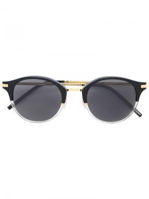 Солнцезащитные очки с круглой оправой Boucheron. Цвет: чёрный