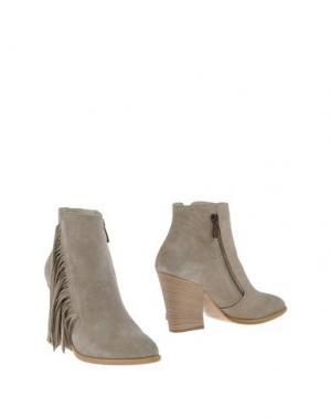 Полусапоги и высокие ботинки SALVADOR RIBES. Цвет: серый